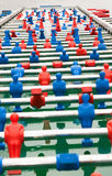 Football table with red and blues colors. A photo of a long football table with red and blue colors in outdoor Royalty Free Stock Photo