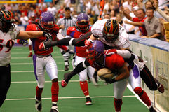 Football tackle blur. An American football player being jumped on and tackled (motion blur stock image