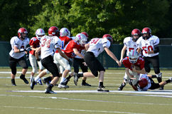 Football Tackling the Runner Stock Photo