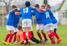 Football Team Celebrating Stock Photo