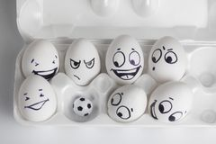 football team. eggs with funny faces. eggs and ball stock photo