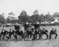 Football team in field. (All persons depicted are no longer living and no estate exists. Supplier grants that there will be no model release issues royalty free stock photo