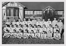 1959 Football Team in Front of School Stock Photo