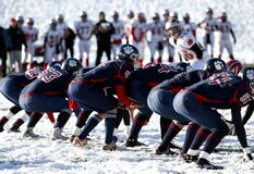 Football Team on Ice during Daytime Royalty Free Stock Photo
