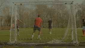 Soccer goalkeeper training with team on the pitch stock video