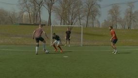 Young footballer scoring a goal during match stock video footage