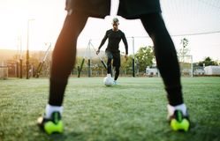 Football team practicing on soccer pitch. Young soccer players training in football field. Football team practicing on soccer pitch outdoors Royalty Free Stock Images