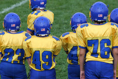 Football Team Sidelines. Colorful football team on the sidelines at a game Royalty Free Stock Image