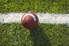 Football on a tee and field viewed from above Royalty Free Stock Photography