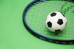Football and tennis racket Stock Photo