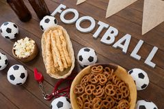 Football text and snacks on wooden table. Close-up of football text and snacks on wooden table Stock Photography