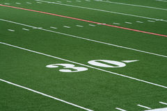 Football Thirty Yard Line. Thirty yard line markers on a football field of artificial turf Royalty Free Stock Photo