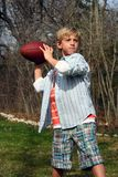 Football Throw. Young cute boy throwing the football stock images