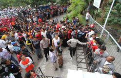 Football ticket queue. Hundred of supporters line up to get a match ticket in sriwedari stadium, solo, central java, indonesia royalty free stock images