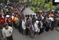 Football ticket queue. Hundred of supporters line up to get a match ticket in sriwedari stadium, solo, central java, indonesia royalty free stock photos