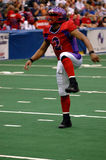 Football touchdown dance. An american football player doing a happy dance after he scores a touchdown (some motion blur royalty free stock photo