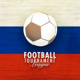 Football tournament league concept with shiny soccer ball on Russ. Ian Flag colors wooden background Royalty Free Illustration
