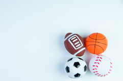 Football toy, Baseball toy, Basketball toy and Rugby toy isolate Royalty Free Stock Photos