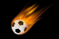 Football with trail of flames Royalty Free Stock Image