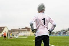 Boy playing soccer football. Boy goalkeeper playing soccer football Royalty Free Stock Photography
