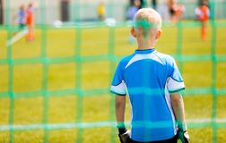 Football Training Game for Kids. Young Boy as a Football Goalkeeper Standing in a Goal stock image