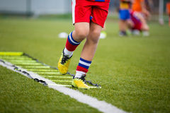 Football training session. Ladder Drills Exercises for Football Soccer team. Young player exercises on ladder drills Royalty Free Stock Images