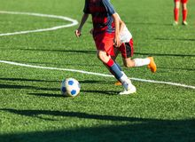 Football training soccer for kids. Boy runs kicks dribbles soccer balls. Young footballers dribble and kick football ball in game. Training, active lifestyle royalty free stock photography