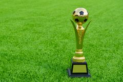 Football trophies. Put on grass green field stock image
