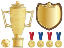 Football trophy. Gold football trophy, shield and medals, isolated on white stock illustration