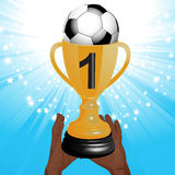 Football trophy with hands and starburst Stock Images