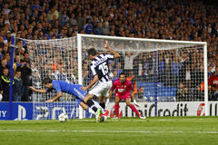 Football UEFA Champions League Chelsea v Juventus. LONDON, ENGLAND. September 19 2012 Chelsea's Belgian midfielder Eden Hazard is fouled by Juventus's Italian Royalty Free Stock Photos