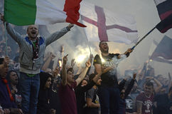 Football ultras with flags and pyrotechnics Stock Photo