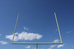 Football uprights. Or goal against blue sky with clouds Royalty Free Stock Photo