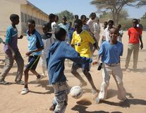Football is very popular among Somali boy. HARGEISA, SOMALIA - JANUARY 8, 2010: Football is very popular among Somali boy. City of Hargeysa in Somalia, capital royalty free stock photo