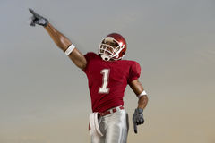 Football Victory. Football player celebrates victory and points at the sky Stock Images