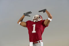 Football Victory. Football player celebrates victory and flexes Royalty Free Stock Photography