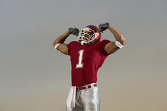 Football Victory. Football player celebrates victory and flexes his muscles Stock Photography