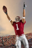 Football Victory. Football player celebrates victory after catching a pass royalty free stock image