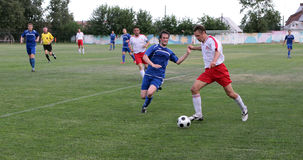 Football. Violent struggle. Football match between Oka and Vidnoye teams in the Beloomut city. 07/03/2010 Stock Photos