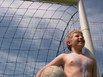 Football - waiting to play. Soccer, ball, goalkeeper, boy, hands, football, sky, blue Stock Photography