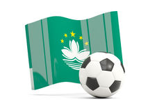 Football with waving flag of macao isolated on white Stock Photos