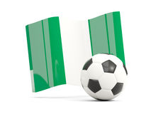 Football with waving flag of nigeria isolated on white Stock Photos
