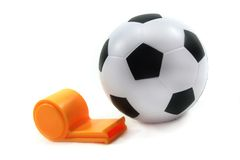 Football with whistle. Soccer with a whistle on a white background Stock Photography