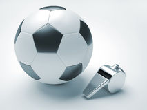 Football and whistle Royalty Free Stock Photo