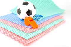 Football and whistle on the color napkins Royalty Free Stock Images