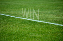 Football Win text on grass with white lane Royalty Free Stock Photography