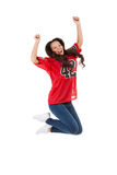 Football: Woman Jumps In Air To Cheer For Team Stock Photo