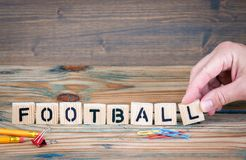 Football. Wooden letters on the office desk. Sports entertainment and recreation background Stock Photo