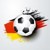 Football world or european championship with ball and germany flag colors. Football with grunge flag in the background. Flag with the colors of germany, perfect Royalty Free Stock Images