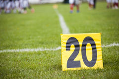 Football yard line with a sign in the foreground Royalty Free Stock Photos